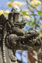 Bali museum carved stone demon statue this intricately like figure is one of many statues that form part of in denpasar Royalty Free Stock Image