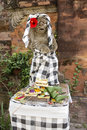 Bali statue with food offerings a stone dressed in a traditional checked cloth and a flower has received a number of from Royalty Free Stock Images