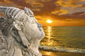 Bali sunset with traditional statue Royalty Free Stock Images