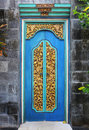 Bali wood carved doors typical carving in Stock Photography