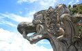 Balinese Dragon Statue Against Blue Sky Royalty Free Stock Photo