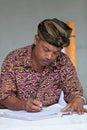 Balinese man maintain records in register book tampak siring bali indonesia sep temple puru tirtha empul on sep tampak Stock Photos