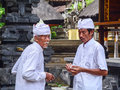 Balinese men at the Tanah Lot temple in Bali, Indonesia Royalty Free Stock Photo