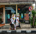 Balinese men walking on street at Ubud village in Bali, Indonesia Royalty Free Stock Photo