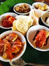 Balinese taster dishes assorted cuisine a photograph showing an assortment of many variety of bali cooking placed in small Stock Image