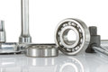 Ball bearing with drive socket set on over white and reflections Royalty Free Stock Photos