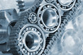 Ball bearings and engineering parts gears chains concept in blue Royalty Free Stock Photography