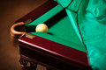 Ball in billiard pocket on partly covered table Royalty Free Stock Image