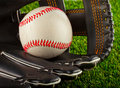 Ball and glove a baseball inside a baseball over white background Stock Photography
