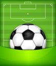 Ball on green field background Royalty Free Stock Photos