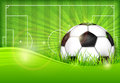 Ball on green field background Royalty Free Stock Image