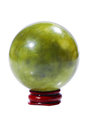 Ball of green jade stone on the stand isolated white Stock Photos