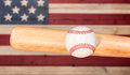 Ball hitting wooden bat with faded boards painted in American US Royalty Free Stock Photo