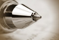 Ball point pen extreme close up shot of in sepia color Royalty Free Stock Photography
