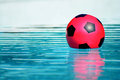 Ball in pool a red floating a swimming closeup Royalty Free Stock Photo