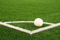 Ball prepared for corner kick. Heated football playground. corner on artificial green turf ground with painted white line marks. Royalty Free Stock Photo