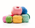Ball of wool different color balls on white surface Royalty Free Stock Photo