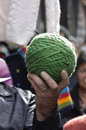Ball of wool hand holding a green Stock Photos