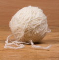 Ball of yarn white on a wooden background Royalty Free Stock Image