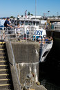 Ballard lock gate opens for argosy cruise ship gates open after water level has been equalized Royalty Free Stock Photo
