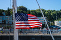 Ballard lock yacht flying american flag going through the Stock Photo