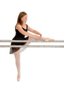 Balleriana at the dance barre a teenage ballerina stretches ballet bar Stock Photo