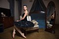 Ballerina in black tutu sitting in front of mirror armchair Stock Photos