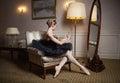Ballerina in black tutu sitting in front of mirror Royalty Free Stock Photo