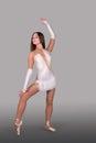 The ballerina dances in pointes Stock Photography