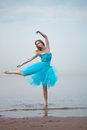 Ballerina dancing on the beach Royalty Free Stock Photography