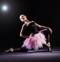 Ballerina dancing in the dark studio Stock Image