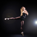Ballerina dancing in the dark studio Royalty Free Stock Images