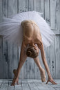 Ballerina dressed in white tutu makes lean forward Royalty Free Stock Photo