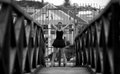 Ballerina in front of gate a black and white photograph a outside her studio she is standing a ona bridge Stock Photo