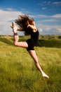 Ballerina jumping in a field Royalty Free Stock Photo