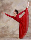 Ballerina posing in red dress Stock Photos