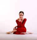 Ballerina posing in red dress Royalty Free Stock Images