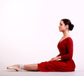 Ballerina posing in red dress Stock Photo
