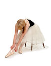 Ballerina preparing pointe shoes ballet student ties to prepare for performance Stock Photos