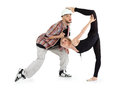 Ballerina put foot on head of man and breakdancer Royalty Free Stock Images