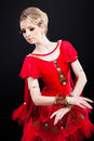 Ballerina in red tutu posing on black Royalty Free Stock Photography