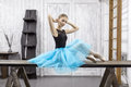 Ballerina sits on table Royalty Free Stock Photo