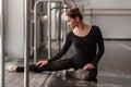 Ballerina sitting on the floor in ballet class Royalty Free Stock Photo