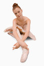Ballerina sitting on the ground Stock Photo
