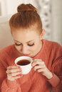 Ballerina tea drinkers portrait pretty young close up the girl in the pink sweater Stock Images