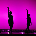 Ballerinas silhouette while they are dancing with color background Royalty Free Stock Photography
