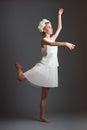 Ballet dancer beautiful girl wearing white dress gray background Stock Photography