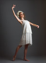Ballet dancer beautiful girl wearing white dress gray background Stock Photo