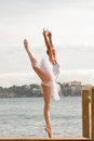 Ballet dancer dancing outdoors by the sea Stock Photography