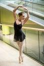 Ballet dancer at escalator dancing in modern business premises Royalty Free Stock Image